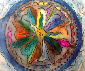 This colorful piece of artwork featuring a mandala was created by a participant in Mobius Inc.'s Creative Expressions program, which provides opportunities for people with developmental disabilities to explore a wide range of art mediums and crafts.