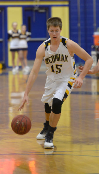 Kyle Donlin brings teh ball up the court for the Panthers. (Paula Roberts photo)
