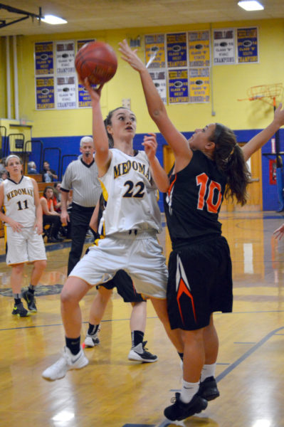 Sadie Cohen drives to the hoop in Medomak Valley girls basketball team's KVAC opener Friday night. (Carrie Reynolds)