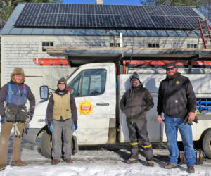 A crew from ReVision Energy poses in front of an installation on Peter Christine's barn roof. The installations add property value in addition to providing tax benefits and reducing electricity bills. (Photo courtesy Peter Christine)