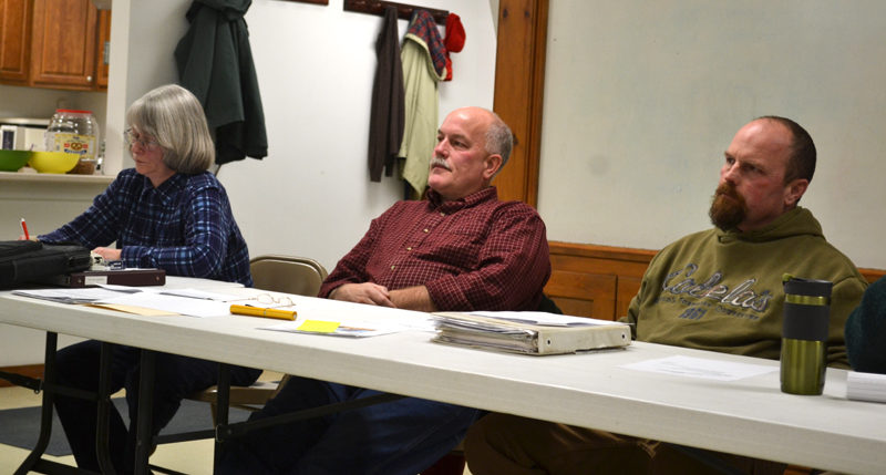 From left: Alna Planning Board members Beth Whitney, Peter Tischbein, and Sean Day listen to feedback about the board's draft fireworks ordinance during a public hearing on Monday, Jan. 9. (Abigail Adams photo)