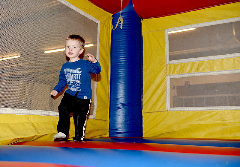 Thomas Roberts, 2, of Damariscotta, bounces in a Sandcastle Entertainment inflatable at a birthday party. The Bristol business offers inflatables, games, and obstacle courses for any age. (Paula Roberts photo)