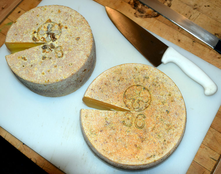 The Creamery at Bristolhof makes two varieties of cheese. Each wheel is numbered and stamped with the creamery's logo. (J.W. Oliver photo)