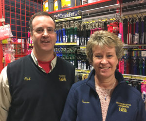 Rob Gardiner and Susan Geyer in the pet section at Damariscotta Hardware. The store will give a $20 gift card to everyone who adopts one of the shelter animals on the sponsorship page in this edition.
