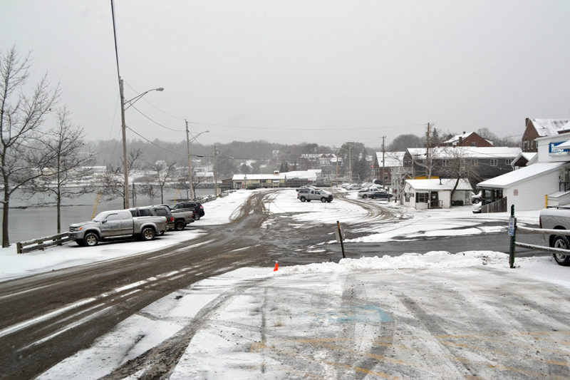 In an effort to complete improvements to the municipal parking lot, including the reconstruction of the lot and the stormwater system, Damariscotta town officials are discussing breaking the project into three phases over five years. (Maia Zewert photo)