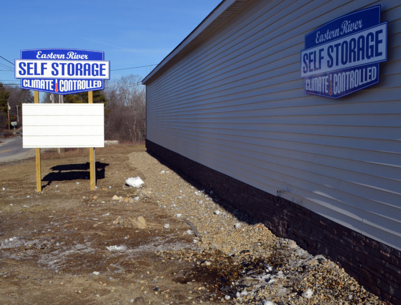 A woman was charged with operating under the influence after the vehicle she was driving struck the Eastern River Self Storage building the evening of Sunday, Jan. 15. (Maia Zewert photo)