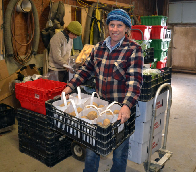 Jan Goranson prepares potatoes for sale in Goranson Farm's cold storage facility Monday, Jan. 2. The farm's new solar installation is expected to cover the facility's electricity needs. (Abigail Adams photo)