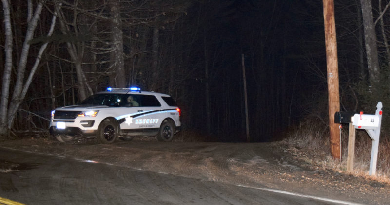 A Lincoln County Sheriff's Office vehicle waits at the end of River Bend Road in Waldoboro shortly after 2 a.m., Sunday, Jan. 22. Deputies closed the gravel road off Winslows Mills Road after a police-involved shooting early Sunday. (J.W. Oliver photo)