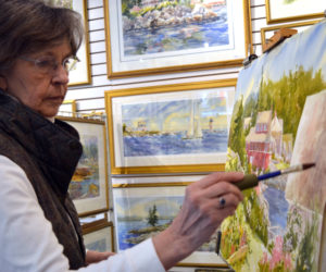 Damariscotta painter Jan Kilburn at work on a watercolor painting in her Bristol Road studio that doubles as an art gallery. (Christine LaPado-Breglia photo)