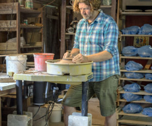Kurt Anderson at work on one of the 500-plus plates needed for the 2017 Watershed Center for the Ceramic Arts Salad Days event, which will take place on July 8. (Photo courtesy Claire Brassil)