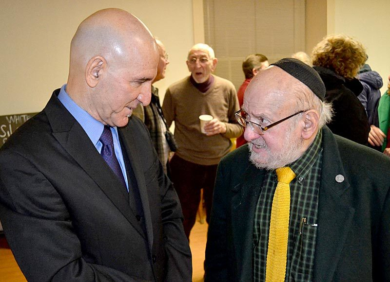 Reza Jalali (left) and Rabbi Steve Shaw speak after a Martin Luther King Jr. Day celebration at The Second Congregational Church in Newcastle on Monday, Jan. 16. (Abigail Adams photo)