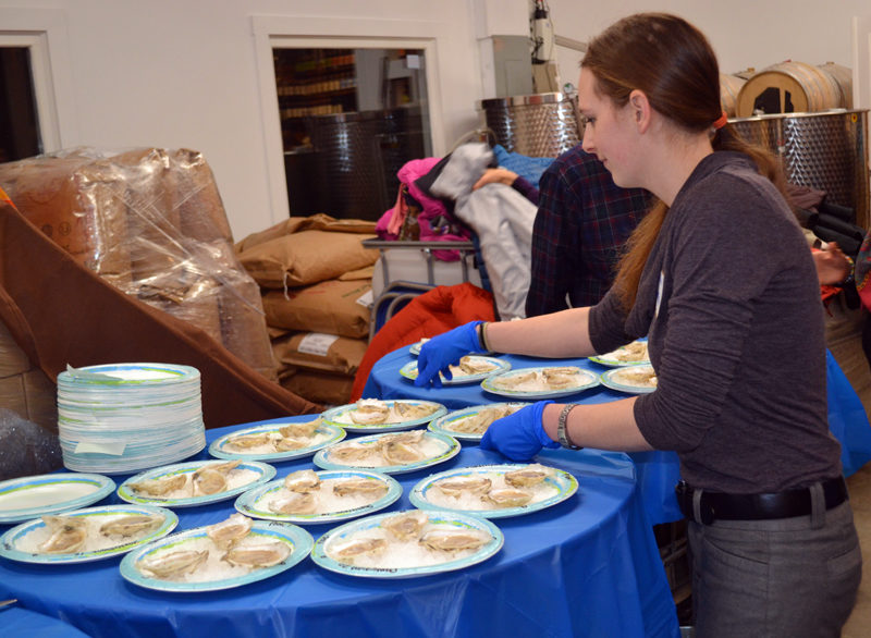 Hellive Jaegerman prepares the first round of Mook Sea Farms' taste test Friday, Jan. 6. (Abigail Adams photo)