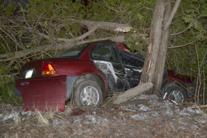 A Saturn crashed into trees the late afternoon of Sunday, Jan. 1 after hitting the patch of black ice on Route 32 in Waldoboro that caused an accident in the same location two days before. (Abigail Adams photo)