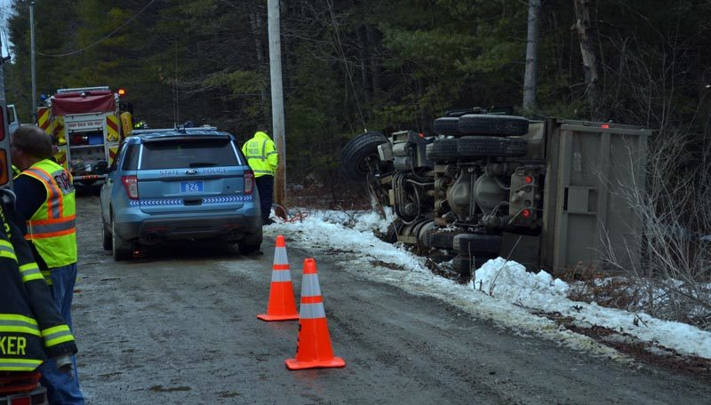 Ambulance, fire, and law enforcement personnel work at the scene of a fatal accident on Doyle Road in Whitefield the afternoon of Friday, Jan. 20. (Abigail Adams photo)