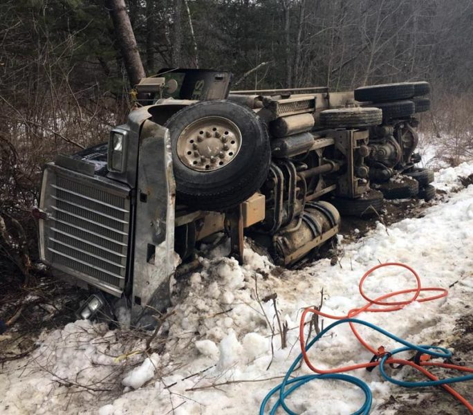 A West Gardiner man died when the dump truck he was driving rolled onto its side on Doyle Road in Whitefield the afternoon of Friday, Jan. 20. (Photo courtesy Maine State Police)