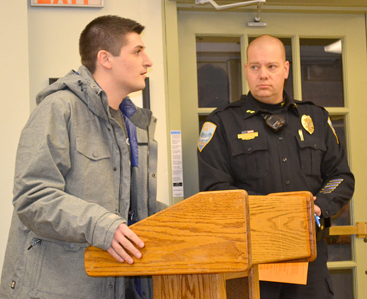 Nick Buscanera, whose dog was attacked by pit bulls, asks the Wiscasset Board of Selectmen to support a disorderly house ordinance at the board's Tuesday, Jan. 3 meeting, as Wiscasset Police Chief Jeff Lange looks on. (Abigail Adams photo)