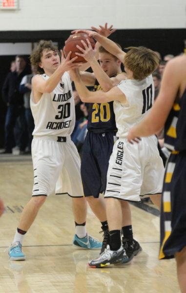 Riley Cushing and Nate Simmons tie up Brent Stewart. (Paula Roberts photo)