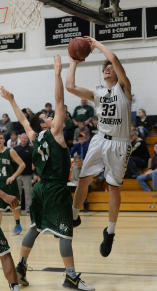 Cody Tozier powers to the hoop for Lincoln Academy. (Paula Roberts photo)