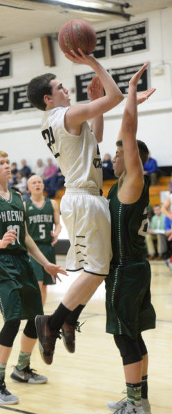 Bryce York shoots over a Spruce Mountain defender. (Paula Roberts photo)