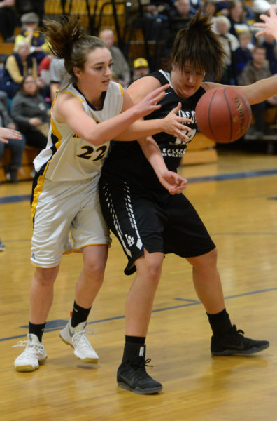Sadie Cohen and Brianna Genthner battle for a rebound in the Lady Eagles win at Medomak. (Paula Roberts photo)
