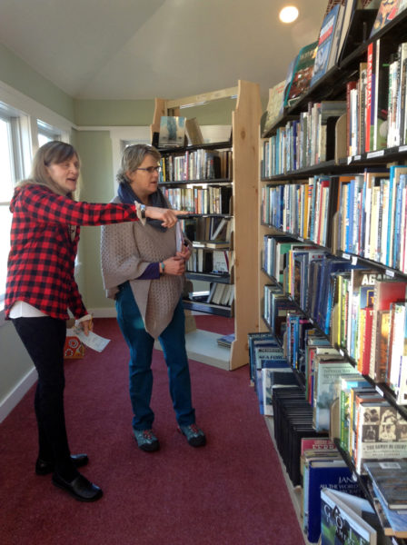Skidompha Secondhand Book Shop volunteers Margaret Gregory (left) and Margot Stiassni-Sieracki discuss labels for the bookshelves at the shop's new location, 17 Backstreet Landing, Damariscotta. The new shop will open at 9 a.m. on Wednesday, Feb. 1.