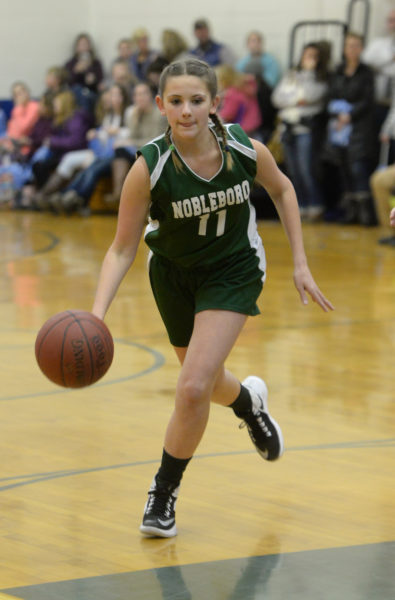 Hayley Phillips brings the ball up court for the Lady Lions. (Paula Roberts photo)