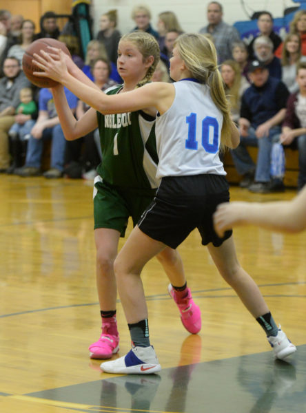 Eliza Spear passes the ball for Nobleboro. (Paula Roberts photo)