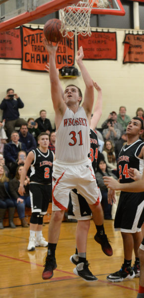Wiscasset senior Ethan James scored his 1,000th career point on this shot, after collecting an offensive rebound on Jan. 25 in Wiscasset. (Paula Roberts photo)