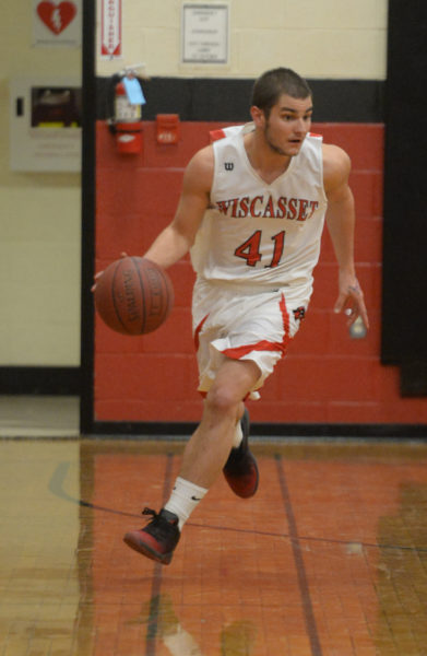 Cody Roberts brings the ball up the court for Wiscasset. (Paula Roberts photo)
