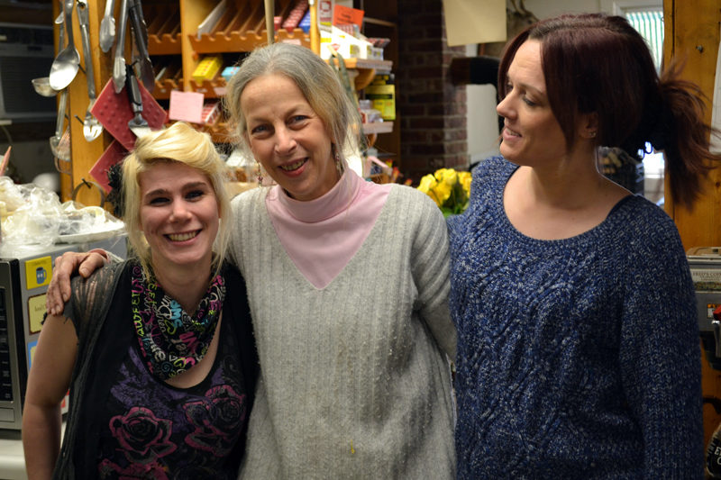 Amy Preston (center) with longtime Alna Store staff members Darci Day (left) and Allison Bailey on Monday, Feb. 27, the day before the store's sale to Ken and Jane Solorzano. (Abigail Adams photo)