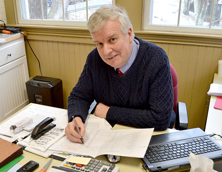 """Bristol Town Administrator Christopher """"Chris"""" Hall at work in the Bristol town office Thursday, Jan. 26. (Maia Zewert photo)"""