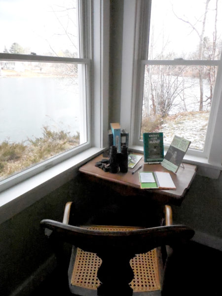 The birdwatcher's nook at the new location of Skidompha Secondhand Book Shop overlooks the Damariscotta River and features bird books, a pair of binoculars, and a nature journal. (Christine LaPado-Breglia photo)