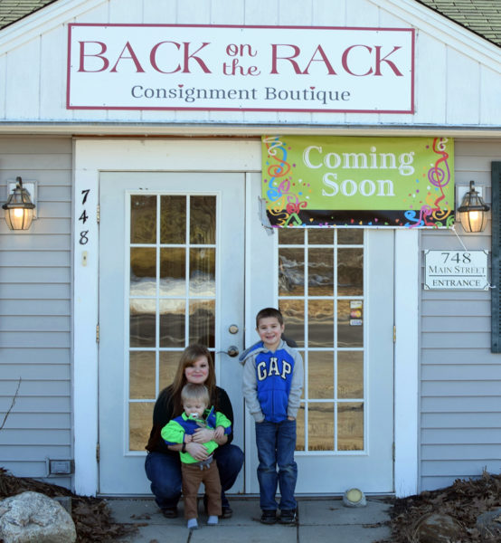 Morgan Wood with her sons, Corbin (left) and Garidyn, at the entrance to Back on the Rack Consignment Boutique in Damariscotta. Wood, of Nobleboro, plans to open the shop by mid-March. (Photo courtesy Morgan Wood)