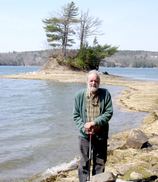Huston Dodge stands in front of the Damariscotta River on the property he donated to the Damariscotta River Association in 2006. (Photo courtesy Damariscotta River Association)