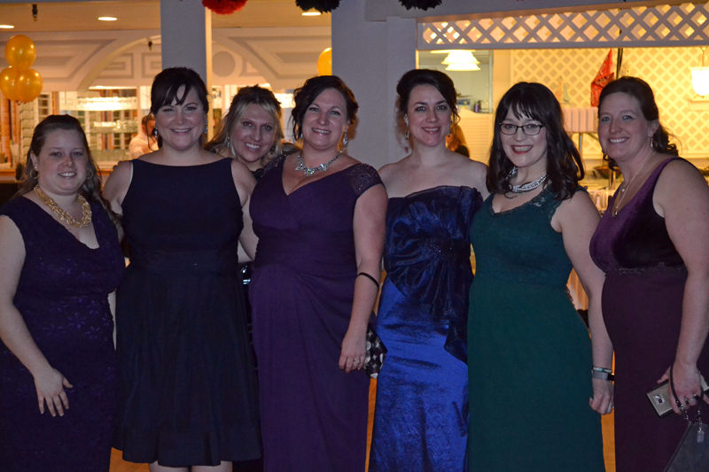 From left: Lincoln County Spark members Sam Mehlhorn, Cerina Leeman, Taylor Corson, Bronwen Hanna, Annie Avantaggio, Brynne Hanna, and Terri Herald attend the organization's fifth annual Snowball at Water's Edge in Edgecomb on Saturday, Feb. 25. (Abigail Adams photo)
