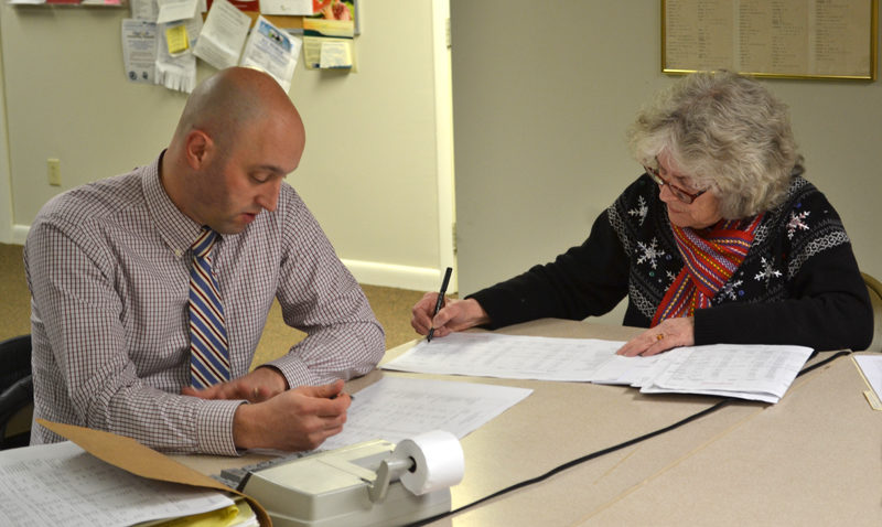 Auditor Fred Brewer and Treasurer Claudia Coffin review town accounts during a meeting of the Edgecomb Board of Selectmen at the town hall Monday, Jan. 30. (Abigail Adams photo)