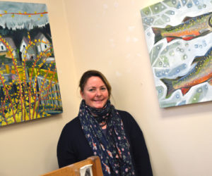 Walpole artist Susan Bartlett Rice stands in a corner of the Bristol Area Library containing two of the paintings in her winter series on display at the library through Tuesday, Feb. 28. (Christine LaPado-Breglia photo)