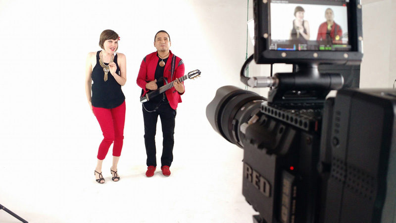 """Emily Sabino and her husband, Lenin Sabino, perform during the recent filming of their music video """"Con Solo Una Mirada"""" at a music studio in Lima, Peru. (Photo courtesy Emily Sabino)"""