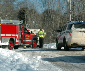 Ambulance, fire, and law enforcement personnel respond to an accident on East Neck Road in Nobleboro the morning of Tuesday, Feb. 14. (Alexander Violo photo)