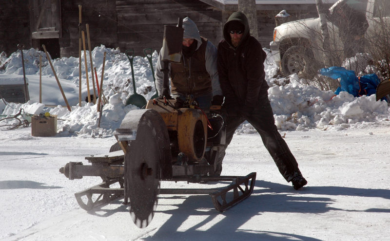 Thompson Ice House Preservation Corp. President Ken Lincoln and his son, Kyle Lincoln, operate an ice saw during the annual ice harvest Feb. 14, 2016. (Maia Zewert photo, LCN file)