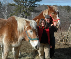 Allison Lakin and Neal Foley with their draft horses at East Forty Farm and Dairy on Friendship Road in Waldoboro. (Alexander Violo photo)