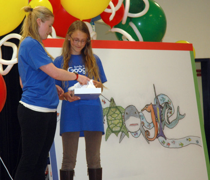 Google representative Izzy Parkinson (left) presents Ruth Havener, of Friendship, with a T-shirt featuring her Doodle 4 Google design. (Alexander Violo photo)
