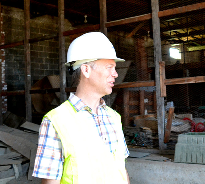 Stephen Dyer, of Ransom Consulting Inc., stands inside the former Mason Station plant's maintenance building during an environmental assessment in May 2016. The Wiscasset Board of Selectmen accepted Peregrine Turbine Technologies' offer to purchase the maintenance building Monday, Jan. 30.  (Abigail Adams photo, LCN file)