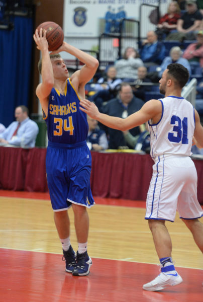 Carter Babcock shoots over Madison's Nick Morales. (Carrie Reynolds photo)