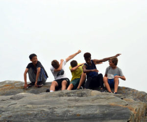 Lincoln Academy international students enjoy a fall field trip to Pemaquid Point. The LA Residential Life program is seeking vacation homestay families for February and April vacations. If interested, contact Sarah Kennedy at 563-3596 ext. 223 to find out more. (Photo courtesy Missy Abbott)