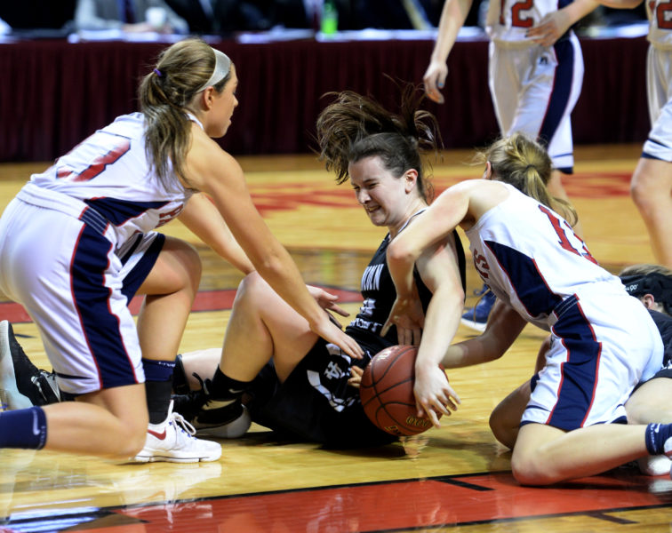 Anna Hatch dives on the floor for a loose ball. (Carrie Reynolds photo)