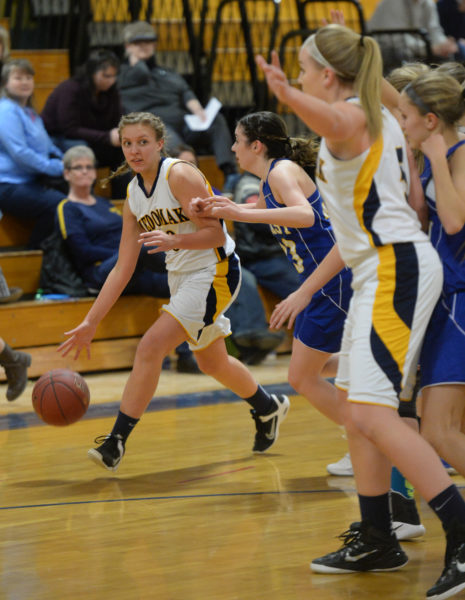 Medomak senior Amber Hagin brings the ball up the court and looks inside to pass to Panther teammate Gabby DePatsy. (Paula Robertys