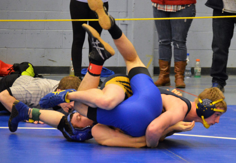 Medomak Valley senior Steven Thompson wraps up Erskine's William Bourque. Thompson won the 138 pound KVAC title and was named wrestler of the meet.  (Carrire Reynolds photo)