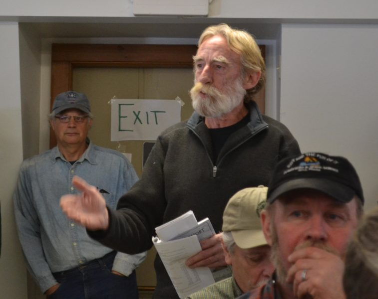Head Tide Dam Committee member Ralph Hilton speaks in favor of entering into a contract with the Atlantic Salmon Federation to modify the dam at Alna's annual town meeting on Saturday, March 18. (Abigail Adams photo)