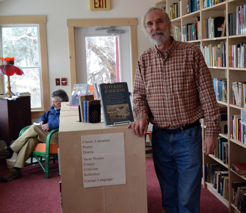 Skidompha Second Hand Bookshop co-manager Rem Briggs in the literature section of the shop's new home at 17 Backstreet Landing on Saturday, March 25. (Abigail Adams photo)